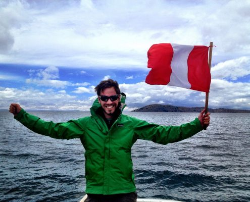 Waving the flag on Lake Titicaca, Peru