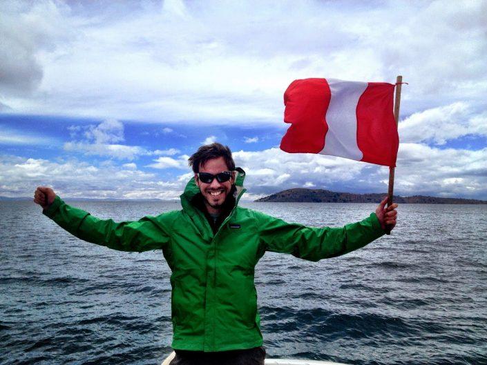 Waving the flag on Lake Titicaca, Peru