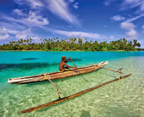 A boy canoeing in the ocean - Papua New Guinea
