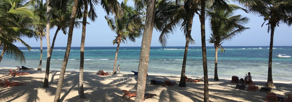 Relaxing with winter sun under palms at Amani Tiwi Beach Resort, Kenya