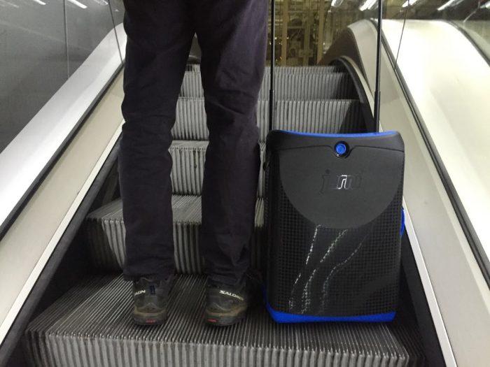 Jurni on the airport escalator