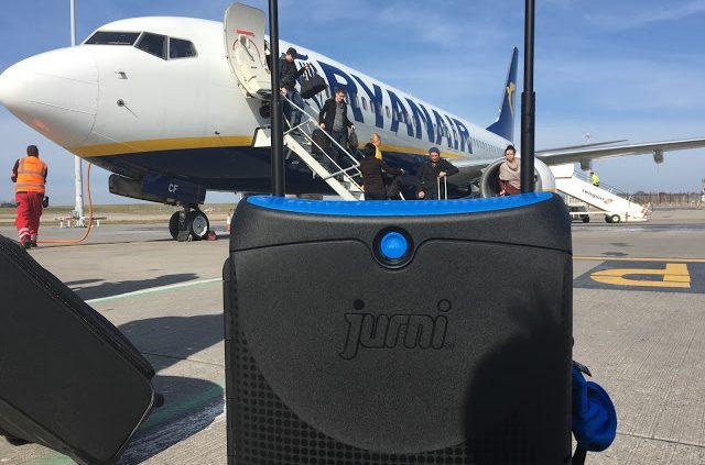 Jurni suitcase next to a Ryanair plane