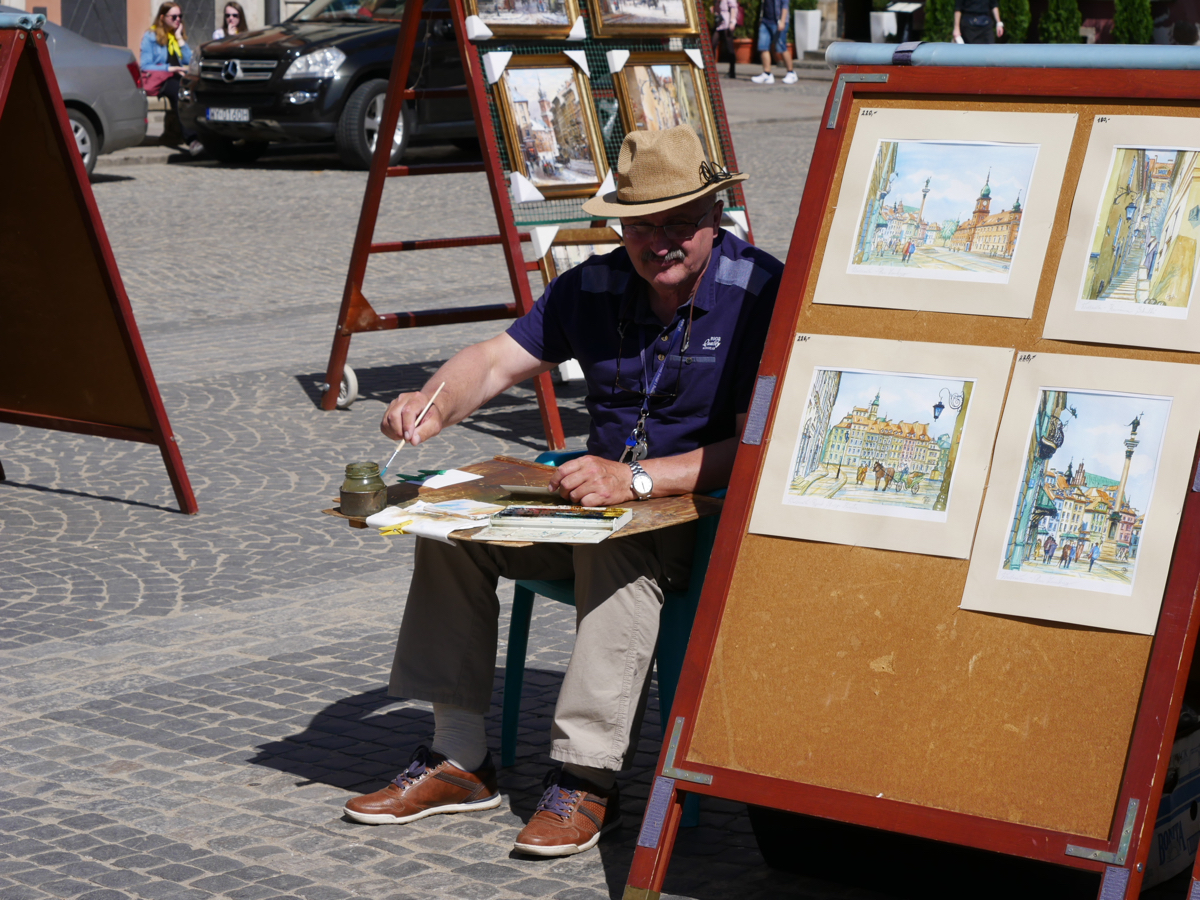 An artist painting in the Old Town Square, Warsaw