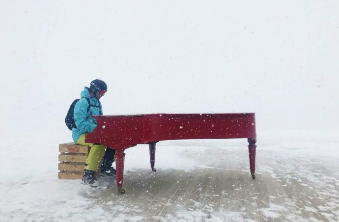 Playing the piano in a blizzard at La Cabane, Alpe d'Huez
