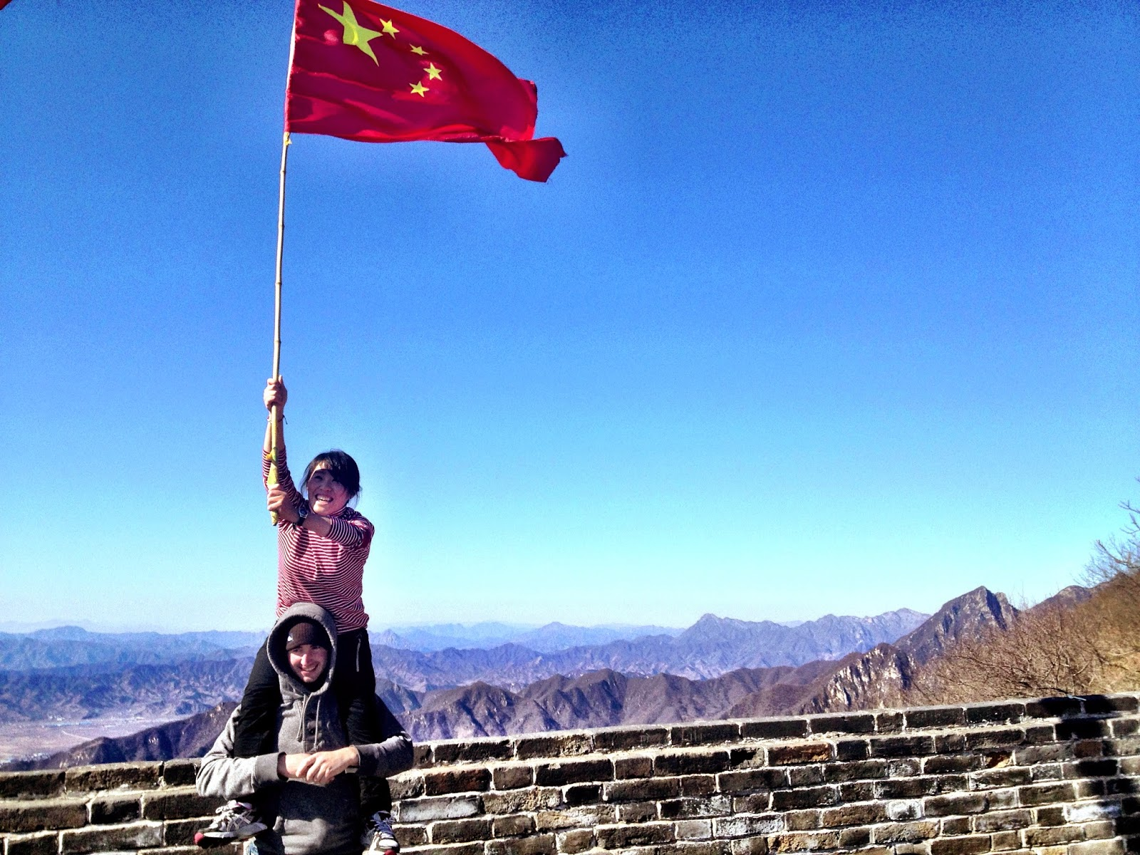Jenny and Jimmy holding the Chinese flag aloft
