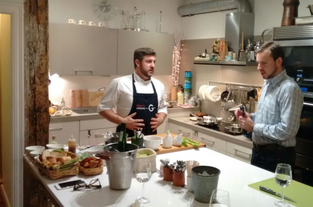 Chatting to chef Íñigo in the kitchen of our pintxos cooking class in San Sebastian - Tenedor Tours