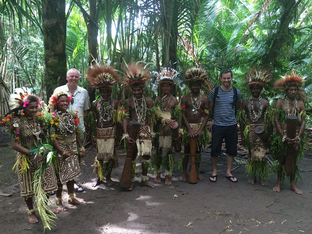 Simon Heyes with a village tribe near Tufi, Papua New Guinea