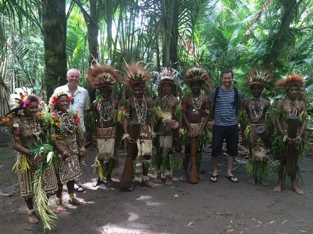 Simon Heyes with a village tribe near Tufi, Papua New Guinea