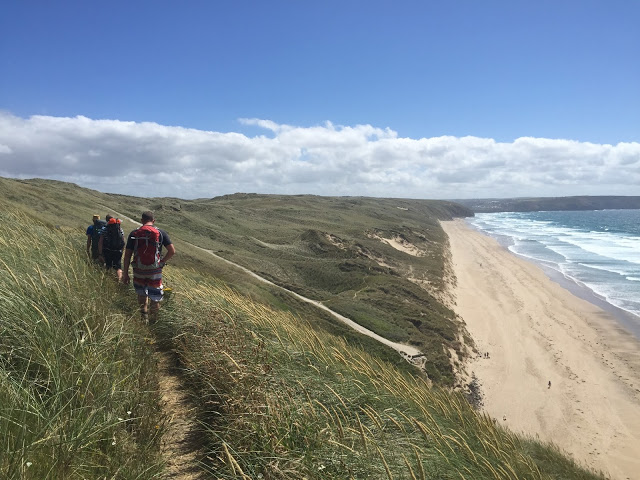 Hiking the South West Coast Path next to Perranporth beach and Perran Sands, Cornwall