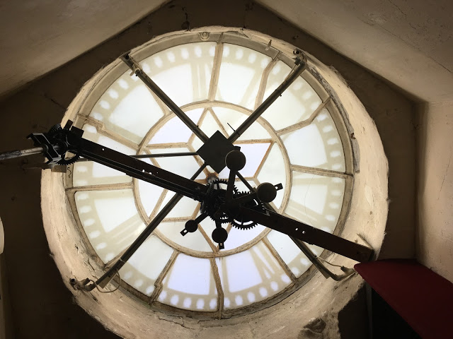 Sitting behind Bath Abbey clock tower - Bath staycation
