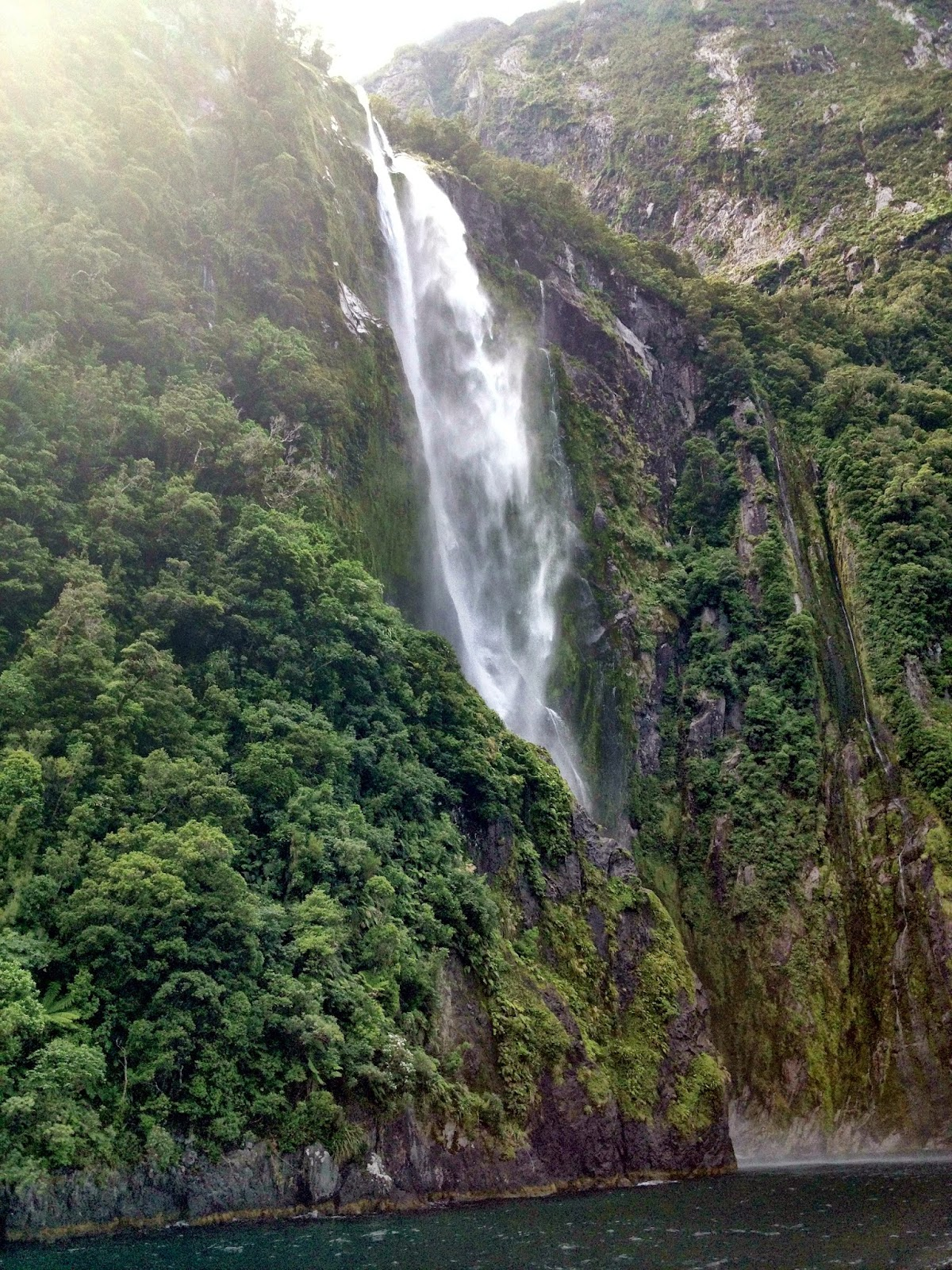 Waterfall in the Milford Sound, Fjordland, New Zealand