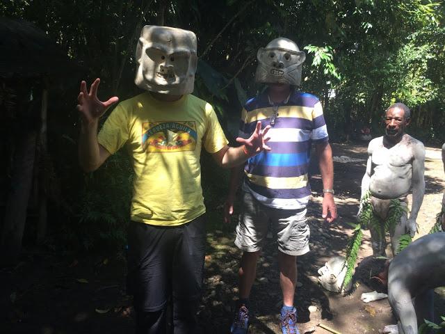 Wearing the clay masks of the mud men - Pogla village, Mount Hagen