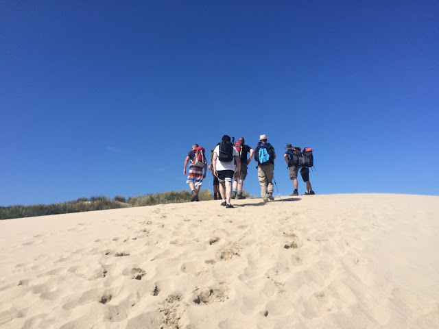 Hiking up a sand dune en route to Newquay - South West Coast Path