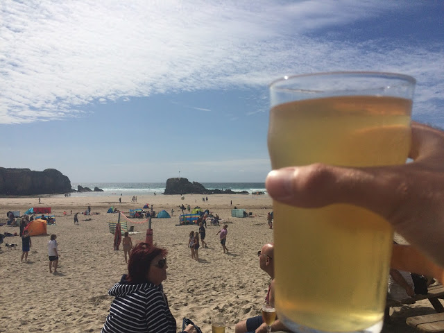 A pint of Rattler in the sunshine at the Watering Hole, Perranporth, Cornwall