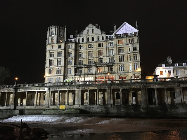 The Guildhall illuminated by the Rec ground floodlights, over the River Avon, Bath