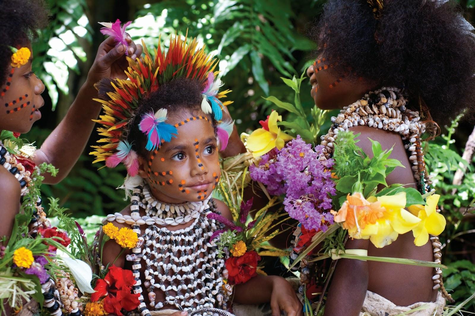 A COLOURFUL YOUNG TUFI GIRL - Papua New Guinea