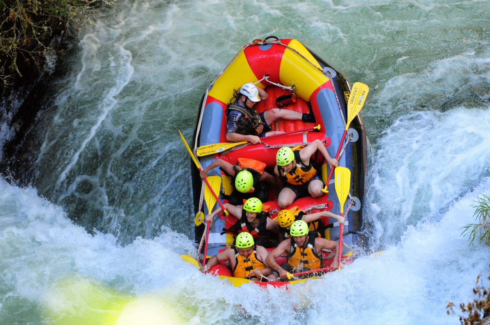 Navigating the first waterfall - white water rafting in Rotorua