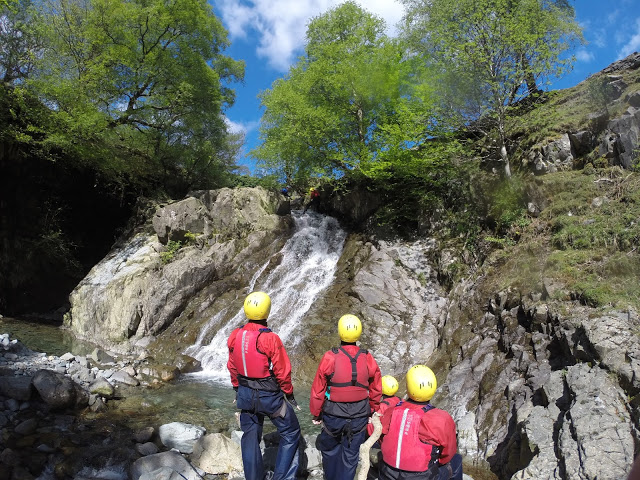 Watching on as the group descends the waterfall at Church Beck