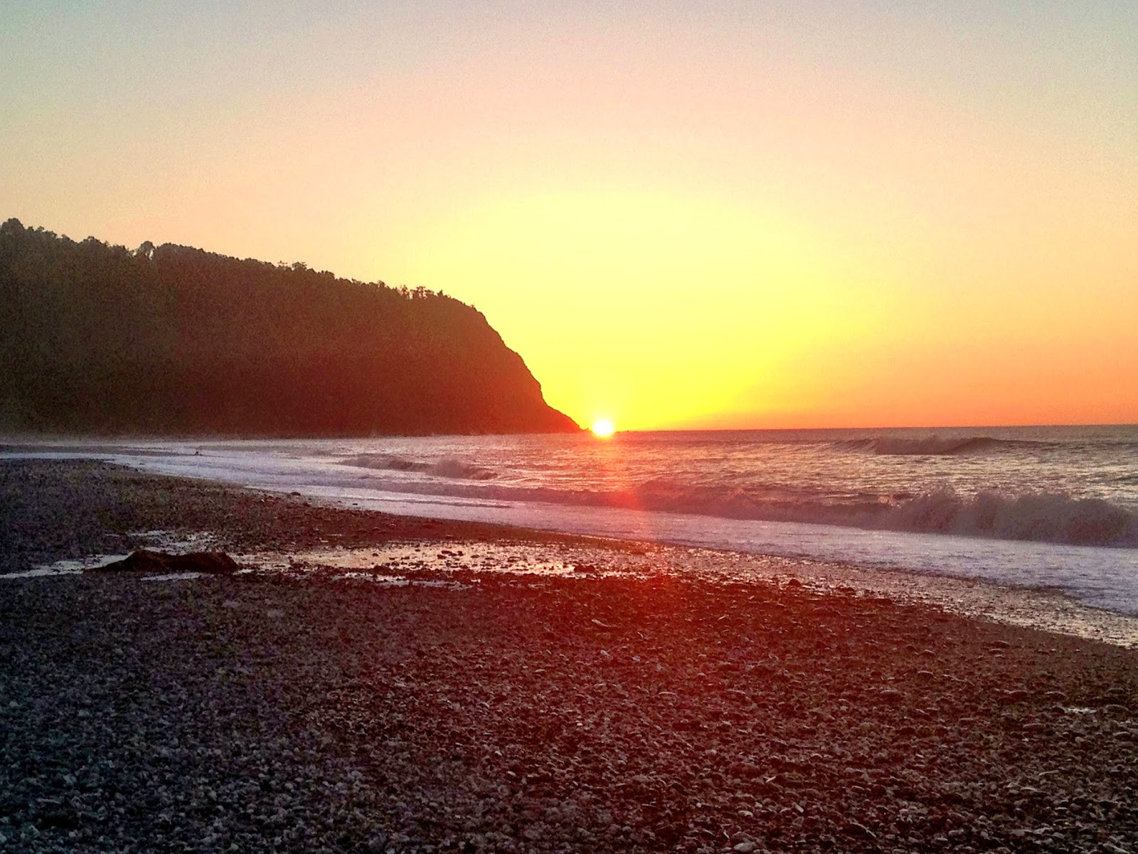 Sunset on the beach of Okarito - South Island, New Zealand
