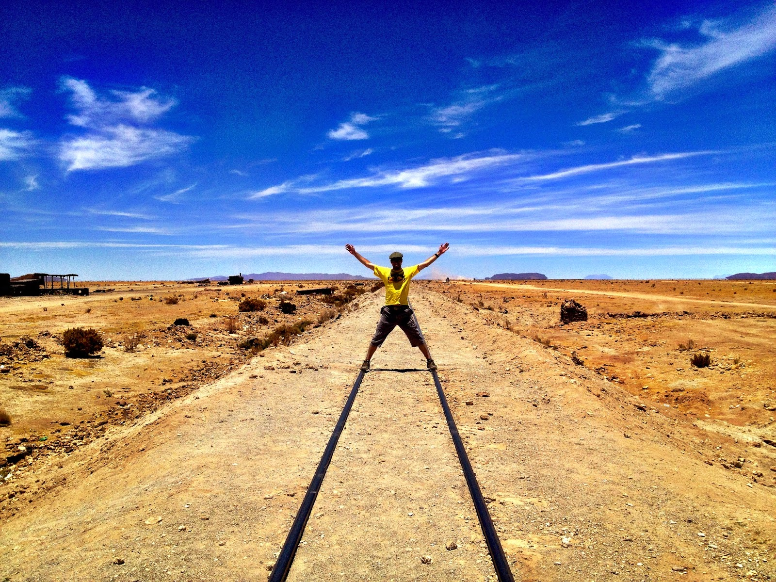 Standing on abandoned train tracks - Uyuni