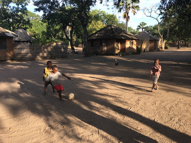 Playing football with the local children, near Liwonde National Park, Malawi