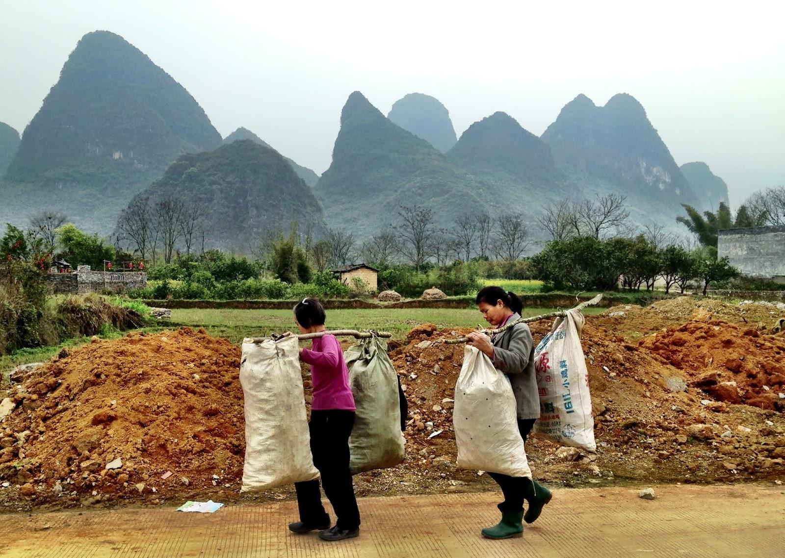 Women carrying sacks - Yangshuo, China