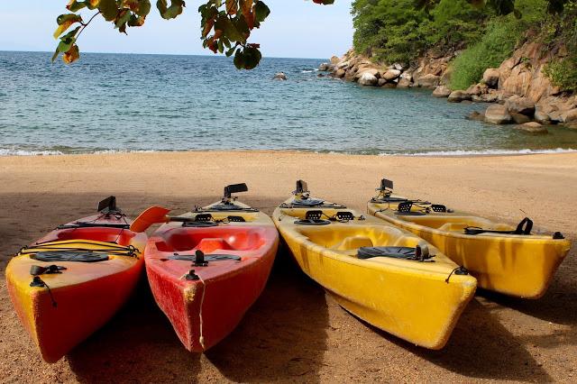 Kayaks awaiting usage on the main beach at Mumbo Island