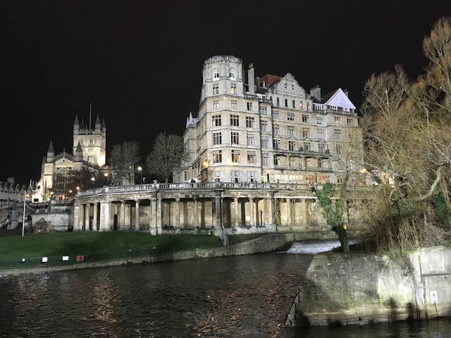 Bath Abbey and The Guildhall illuminated by the Rec ground floodlights, Bath