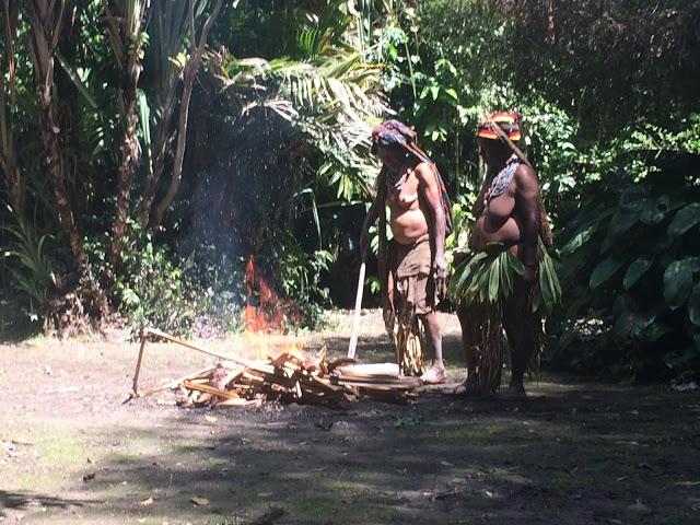 Women in Pogla village reenact the mud men story - Papua New Guinea