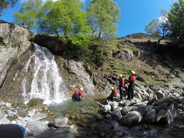 Landing into the pool at the bottom of the first waterfall - Canyoning in Coniston, Lake District