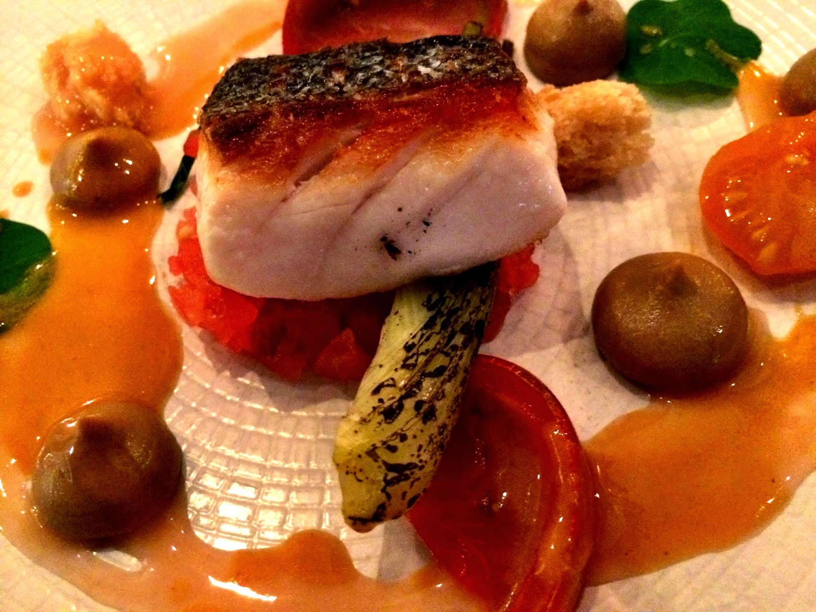 pan-fried fillet of Cornish sea bass, braised fennel, tomatoes and an aubergine puree
